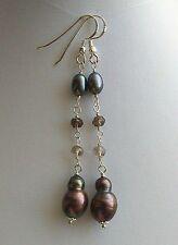 Orecchini con perle barocche grigio scuro rondelle fumè argento 925