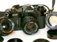 "CANON EF camera (black body) with 3 CANON FD lenses: a great photographic ""kit"""