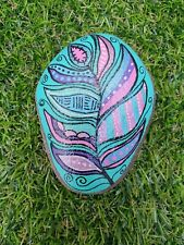 Hand Painted pebble rock stone art Very colourful and ornate peacock feather