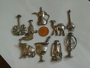 A selection of sterling silver Egyptian type figures Camel date tree jugs etc