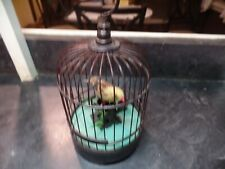 canary in a cage  sings uses batterys