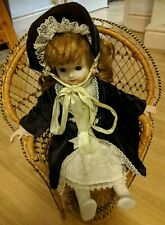 Porcelain Doll in Peacock Chair