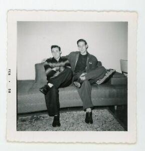 Handsome dapper guys posing on sofa together  Vintage snapshot  photo