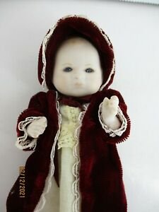"""4"""" Porcelain baby doll, jointed hand painted face darling outfit."""