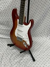 Stratocaster electric guitar, Red Burst with gig bag and accessories.