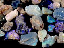 197cts. Lightning Ridge Black/Light Small Opal Gem Rough/rubs. Purples/greens