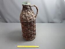 Ancienne petite bonbonne en verre bouteille enrobée osier vintage déco chalet