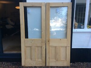 Stripped, reclaimed Victorian pine double doors with replaced glass