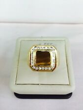 14 k yellow gold diamond ring Tiger Eye Center Stone size 10