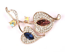 Burgundy and Blue centre Gold Tone Flower Brooch with