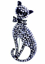 Punk style black cat pin / brooch with a bow