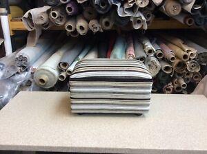 footstool / pouffe upholstered in striped velvet fabric