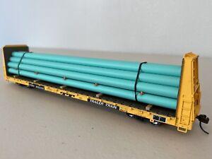 Atlas 20 002 685 :: TTPX Bulkhead Flat Car w/ Pipe Load HO-Scale