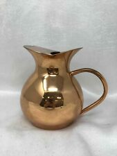 Unmarked copper finish pitcher