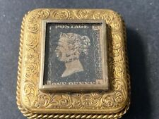 Gilded Metal stamp case, rope beading, decorated w/ 1d Penny Black in window