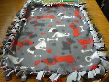 Handmade fleece tie blanket of dogs and bones for a small pet