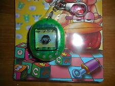 Vintage Pocket My Baby Keychain Pocket Game Green China Japan NIB