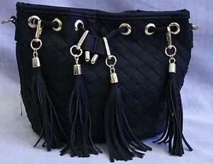 Tassel black draw string handbag with Gold embellishments