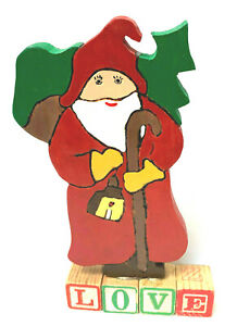 Hand Made Wooden Santa Claus Standing OnTop Of  Vintage Blocks That Read Love