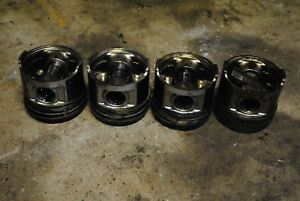 234-4814 Pistons and Pins - 3044C CAT Skid Steer