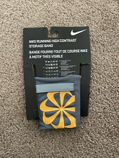 NIKE Unisex Running High Contrast Dri-Fit Refrective Storage Band Size S/M