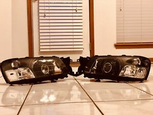 2003-2005 Subaru Forester Retrofitted Headlights With MH1 Projectors + Demon