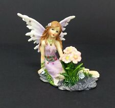 Fairy Figurine Lavender Dress Glitter Rhinestone Accents Next to Pink Flowers