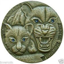 SNOW LEOPARDS 1oz Pure Silver Coin Swarovski Eyes Wildlife Family $1 Niue 2015