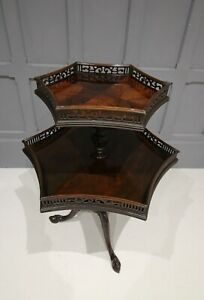 A FLAMED MAHOGANY TWO TIER ETAGERE TABLE