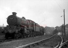 PHOTO  GWR 7029 CLUN CASTLE IN THE SHED YARD AT OLD OAK COMMON 9/63