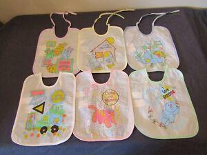 ASSORTED PLASTIC BABY BIBS ( CHOOSE ).
