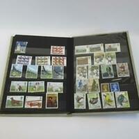 Vintage Collection of Worldwide Stamps with Album - Approximately 235 Stamps