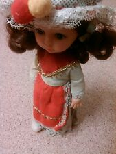 old vintage doll figurine Hong Kong dress blue eyes brown hair cultural country
