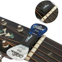 1 Guitar Headstock Rubber Pick Holder + 2pcs 0.81mm Guitar Picks Plectrum