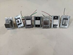 Lot of (7) New Legrand Adorne Touch Softap Dimmer etc. from Store Display Board