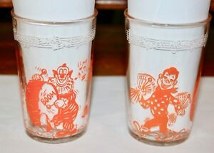 Pair of Welch's Howdy Doody 1953 Parade orange Glass with different bottoms