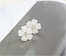 White resin plum flower stud earrings with crystal