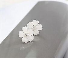 White resin plum flower stud earrings with crystal