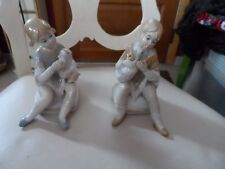 Girl and Boy figurines in muted gray and tan colors holding duck an dog #7363