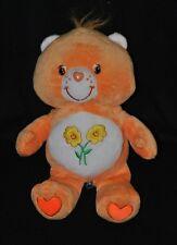 Peluche doudou bisounours orange CARE BEARS Grosbisous fleurs brodées 30 cm TTBE