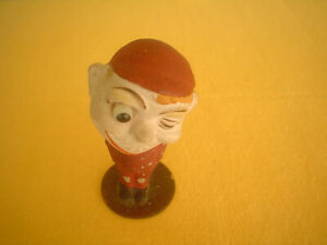 EARLY 1900'S GERMAN WINKING NODDER, WOODEN BASE, RARE, STANDS 4 1/2 INCHES HIGH