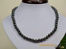 Halsketten und Anhänger aus Edelsteinen mit Hämatit behandelte
