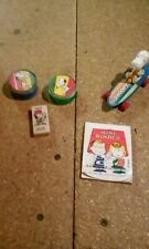 snoopy  pencil sharpeners , book , eraser  and model  on skateboard