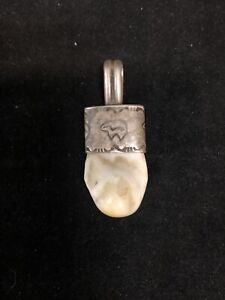 Vintage Sterling Silver and Elk Tooth Pendant