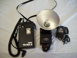 SUNPAK AUTO 120J TTL BARE BULB FLASH WITH BATTERY PAK AND ADAPTER - WORKS