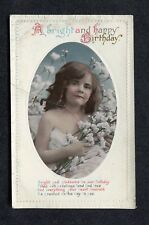 c1920s Birthday Card: Young Girl holding Flowers: Heart Desireth be Granted
