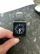 Smart watch with GSM mobile phone and camera