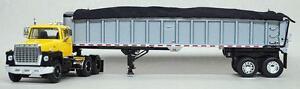 1/64 DCP Ford LN 9000 (Yellow/Black Fenders) w/Silver East End Dump w/Black tarp