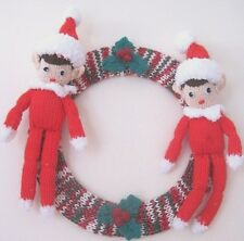 HAND KNITTED WALL WREATH. 10 INCHES DIAMETER. ERIC AND ERNIE XMAS ELVES