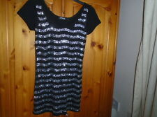 Black hip length top, silver sequin front, keyhole opening back, STYLE, size 8